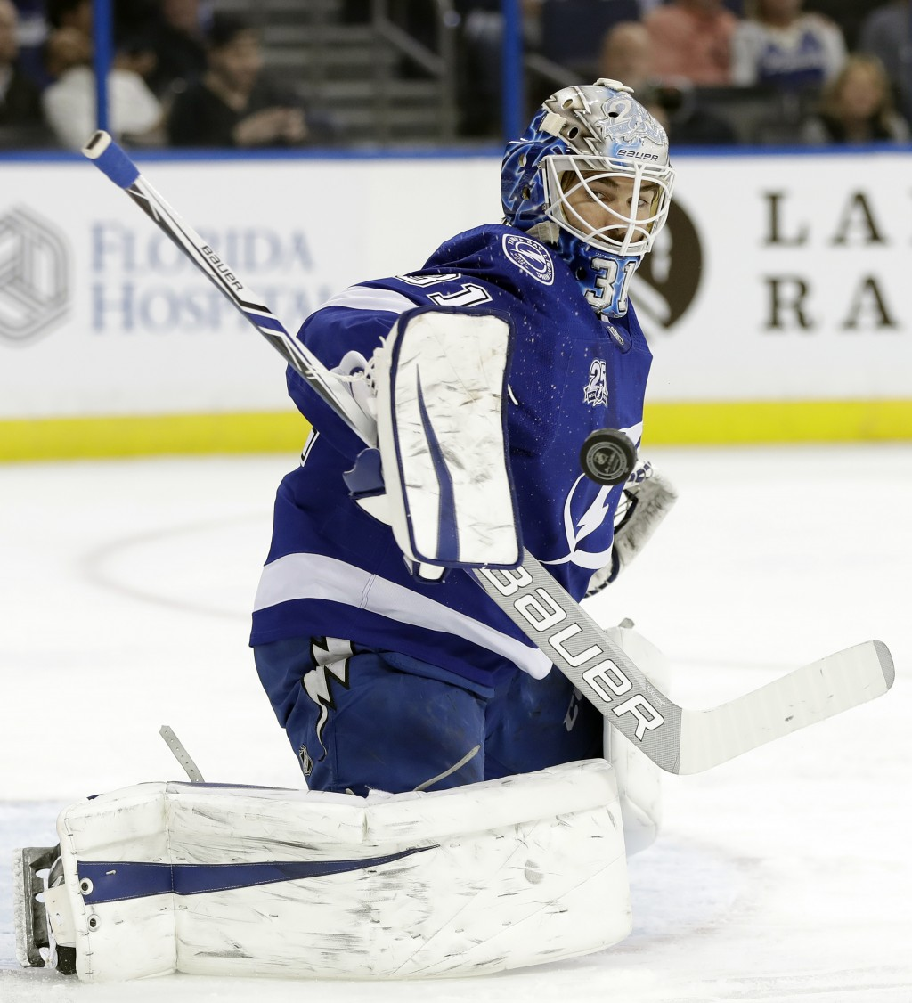 Tampa Bay Lightning goaltender Peter Budaj, (31) of Slovakia, makes a save on shot by the Ottawa Senators during the third period of an NHL hockey gam