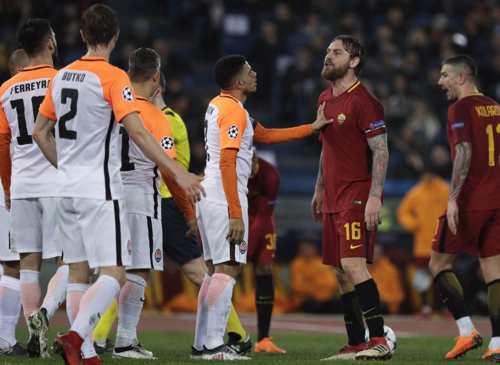 Roma's Daniele de Rossi takes on Shakhtar players during a Champions League round of 16 second-leg soccer match between Roma and Shakhtar Donetsk, at