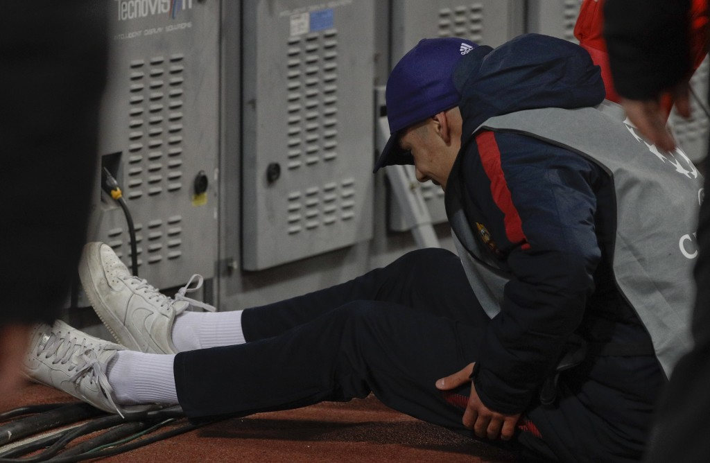 A ball boy lies down after being pushed by a Shakhtar player during a Champions League round of 16 second-leg soccer match between Roma and Shakhtar D