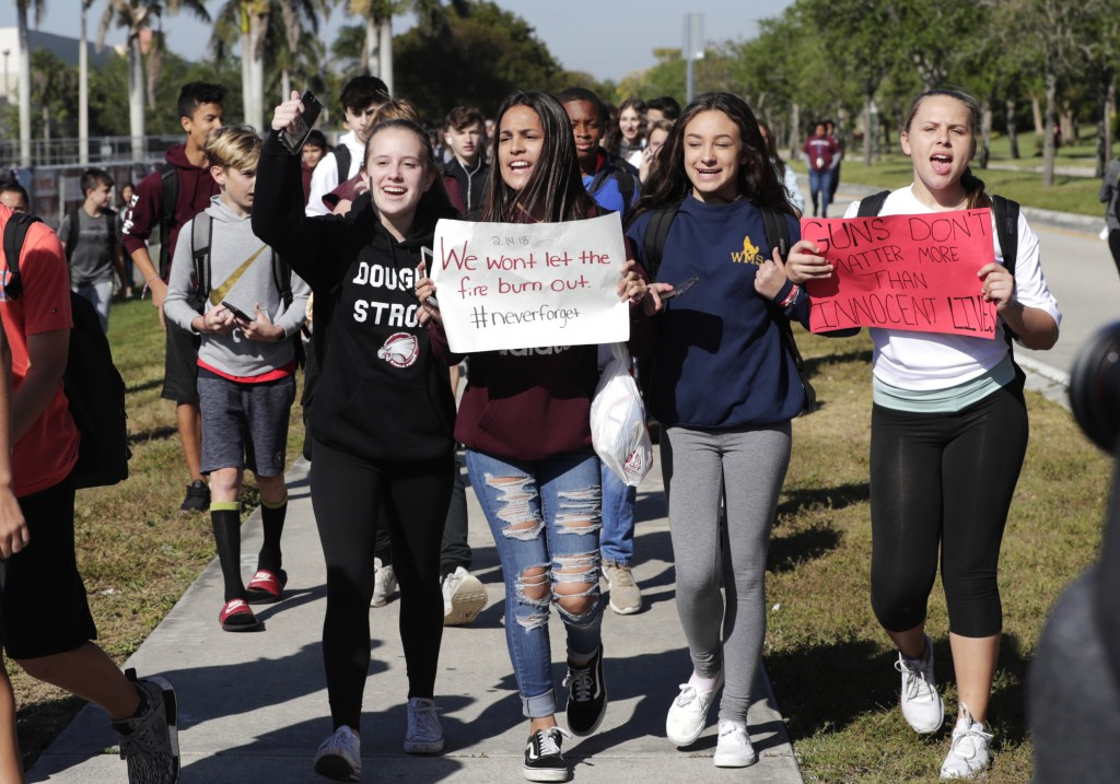 Students from Westglades Middle School walk out of their school as part of a nationwide protest against gun violence, Wednesday, March 14, 2018, in Pa