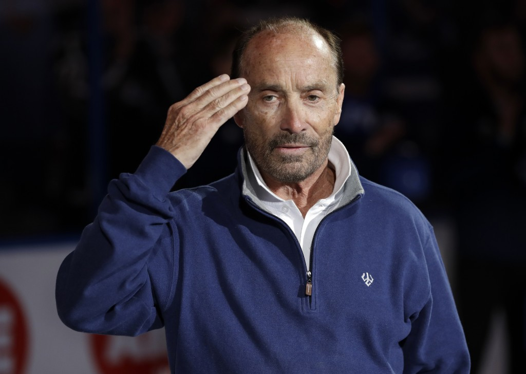 Country entertainer Lee Greenwood salutes after singing the National Anthem before an NHL hockey game between the Tampa Bay Lightning and the Ottawa S