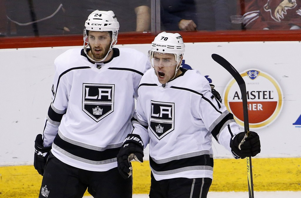 Los Angeles Kings left wing Tanner Pearson (70) celebrates his goal against the Arizona Coyotes with defenseman Derek Forbort (24) during the second p