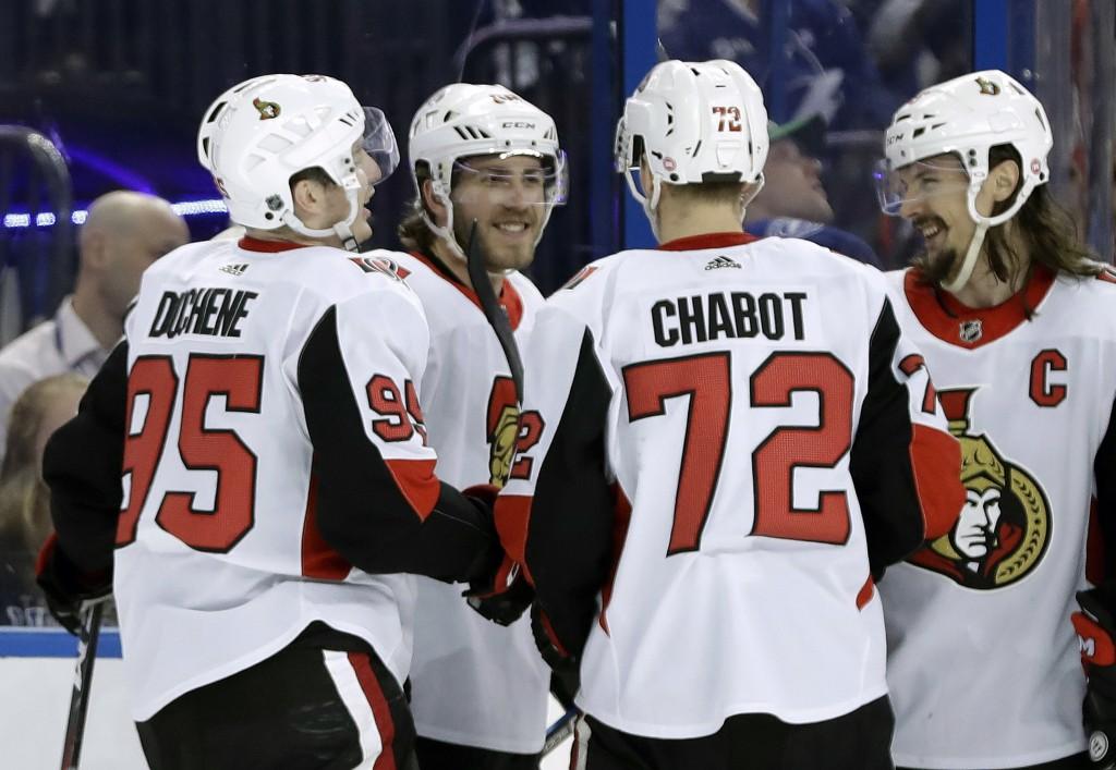 Ottawa Senators left wing Mike Hoffman, second from left, celebrates with defenseman Erik Karlsson, of Sweden, right, defenseman Thomas Chabot, second