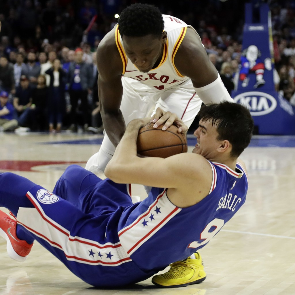 Indiana Pacers' Victor Oladipo, top, and Philadelphia 76ers' Dario Saric battle for the ball during the second half of an NBA basketball game, Tuesday