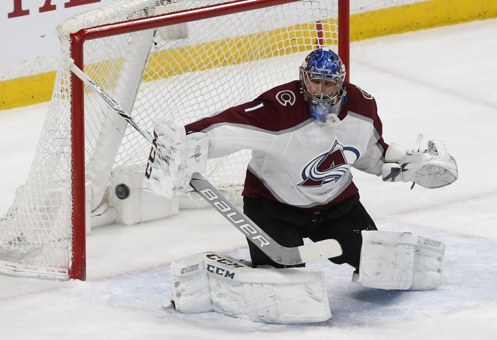 Colorado Avalanche goalie Semyon Varlamov, of Russia, blocks a shot in the first period of an NHL hockey game against the Minnesota Wild, Tuesday, Mar