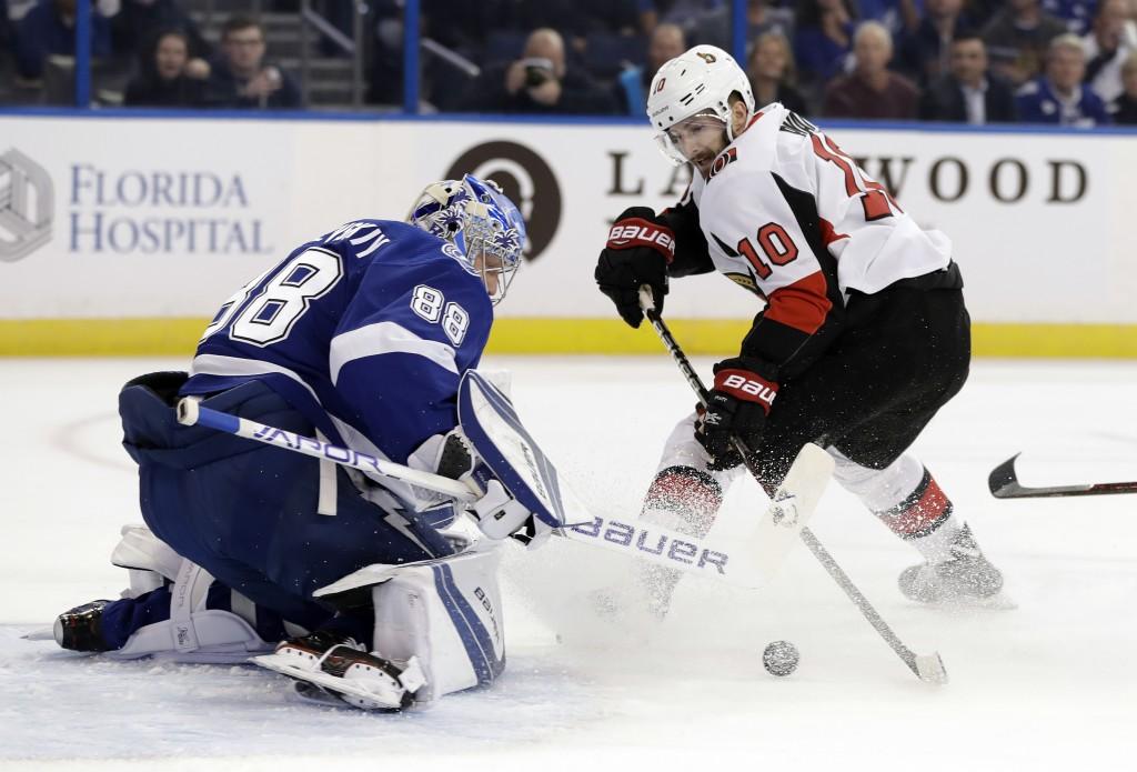 Tampa Bay Lightning goaltender Andrei Vasilevskiy, (88) of Russia, stops a shot by Ottawa Senators left wing Tom Pyatt (10) during the first period of