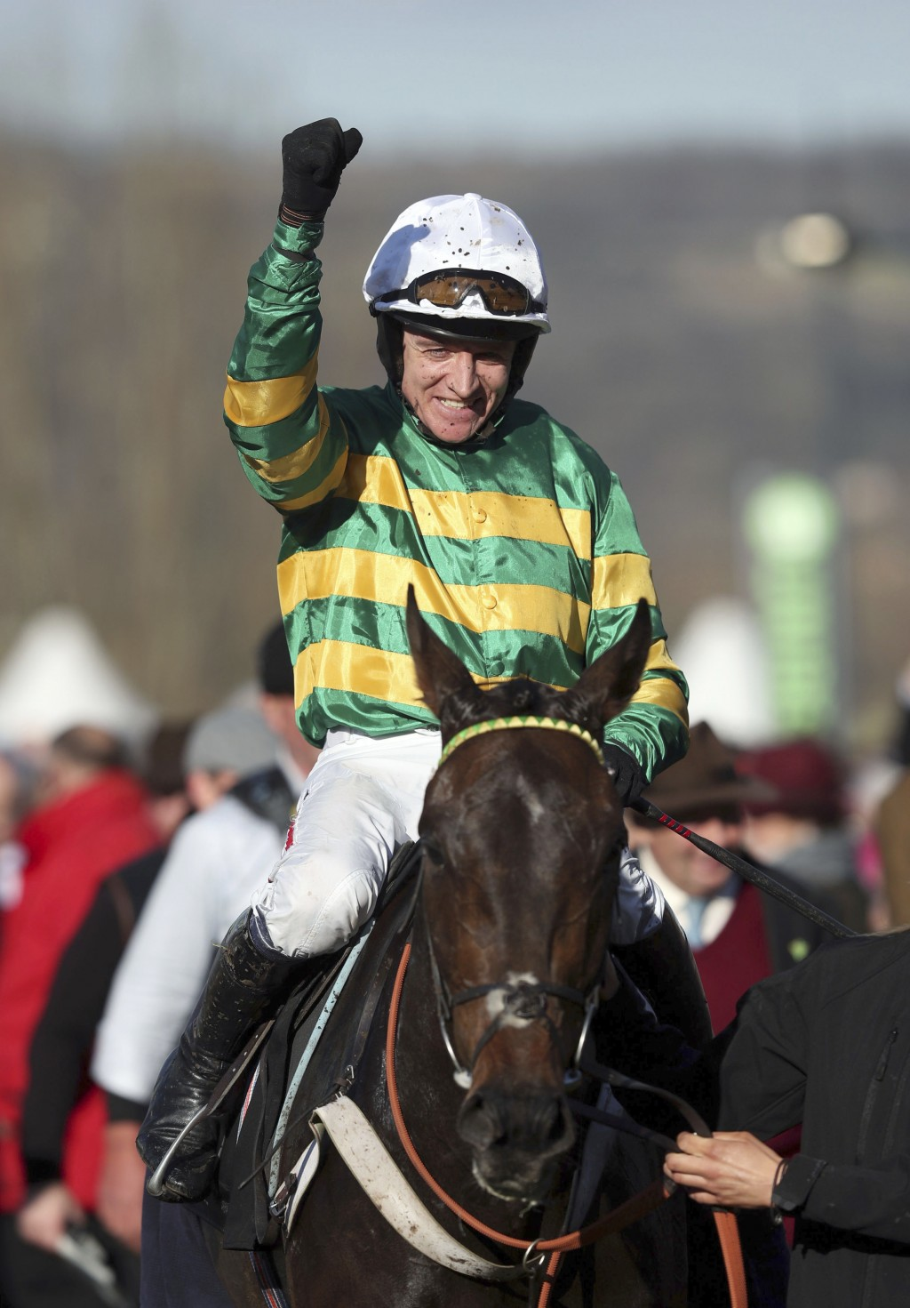 Barry Geraghty celebrates victory in the Champion Hurdle on Buveur D'Air  at Cheltenham Racecourse, Cheltenham England Tuesday March 13, 2018. (David