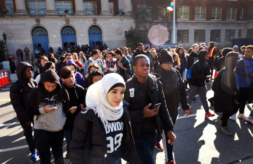 Hundreds of students walk out of Midwood High School as part of a nationwide protest against gun violence, Wednesday, March 14, 2018, in the Brooklyn