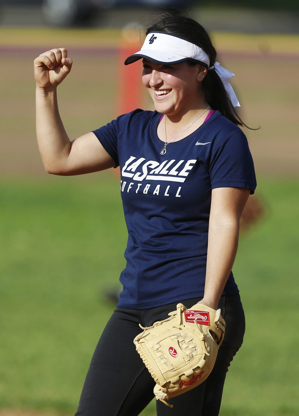 In this Monday, March 12, 2018, photo Katrina Yuzefpolsky celebrates during practice with her La Salle varsity softball team in Pasadena, Calif. Yuzef