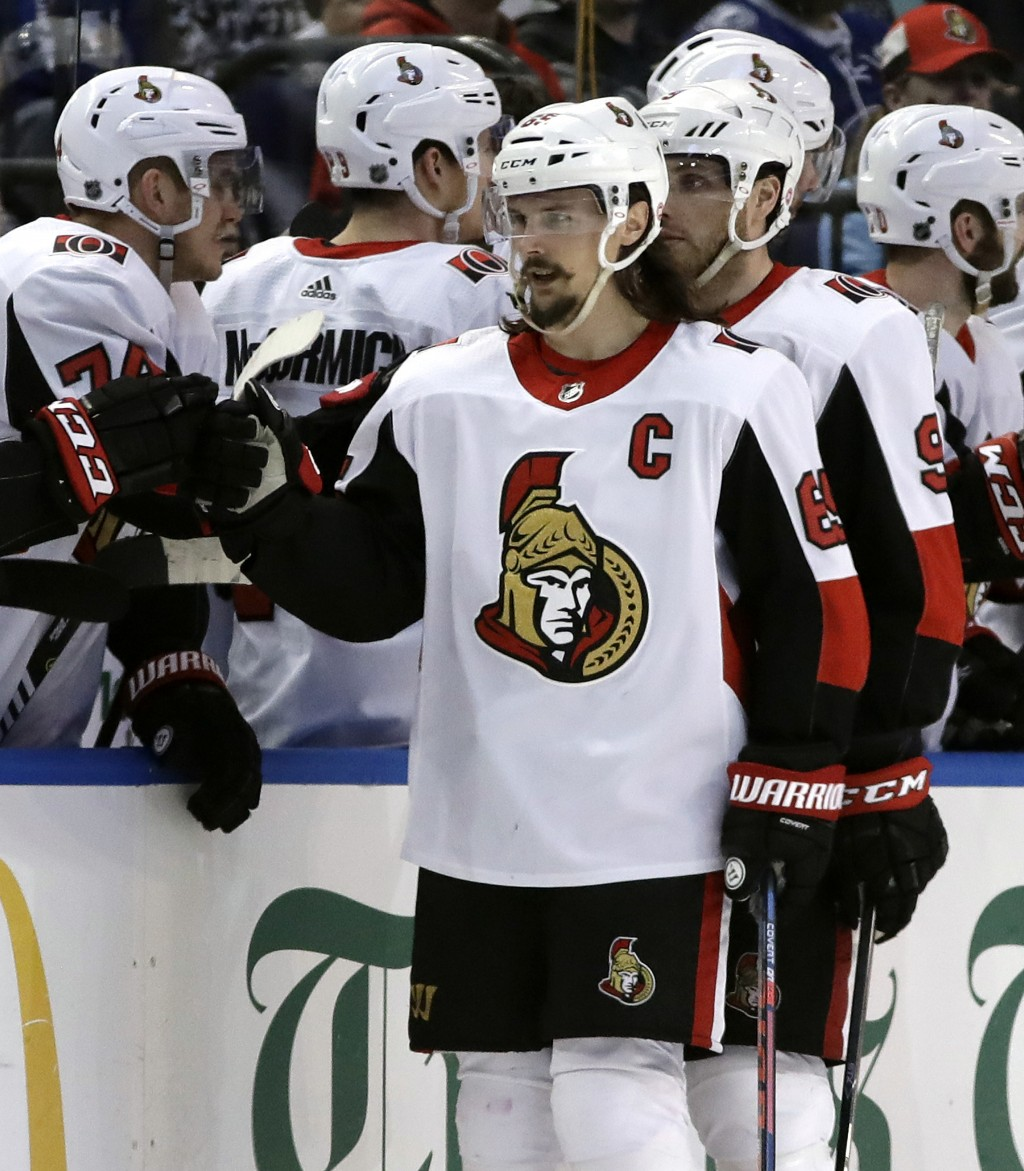 Ottawa Senators defenseman Erik Karlsson, (65) of Sweden, celebrates with the bench after his goal against the Tampa Bay Lightning during the second p