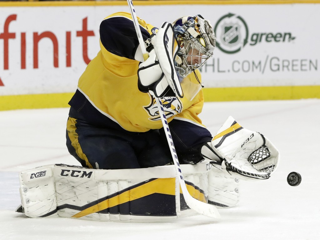 Nashville Predators goalie Pekka Rinne, of Finland, blocks a shot against the Winnipeg Jets in the third period of an NHL hockey game Tuesday, March 1