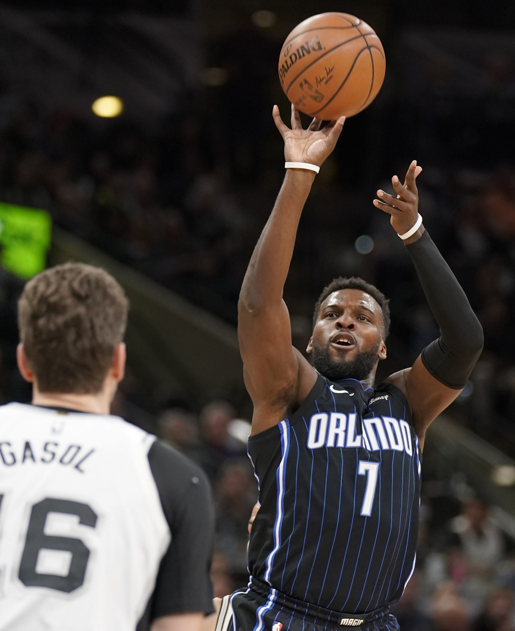 Orlando Magic's Shelvin Mack (7) shoots against San Antonio Spurs' Pau Gasol during the first half of an NBA basketball game, Tuesday, March 13, 2018,