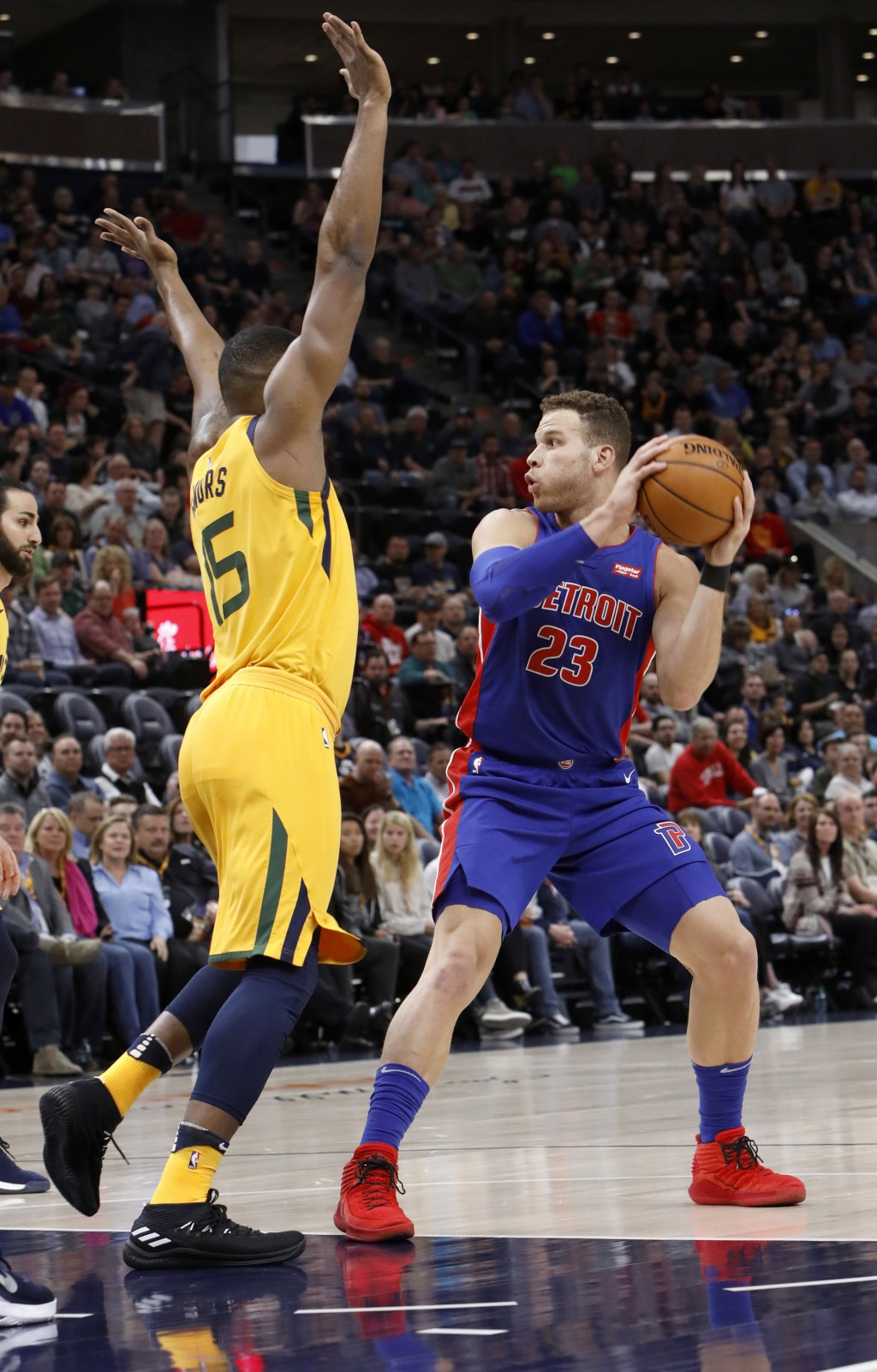 Detroit Pistons' Blake Griffin (23) looks to pass as Utah Jazz's Derrick Favors, left, defends in the first half of an NBA basketball game on Tuesday,