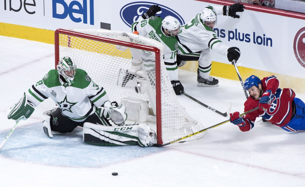 Montreal Canadiens right wing Andrew Shaw (65) tries to score on the wrap-around past Dallas Stars goaltender Kari Lehtonen (32) as he is covered by c