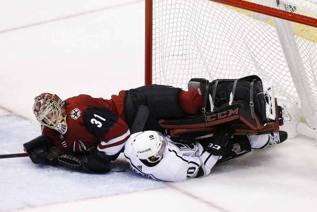Los Angeles Kings center Tobias Rieder (10) takes out Arizona Coyotes goaltender Adin Hill (31) during the second period of an NHL hockey game Tuesday