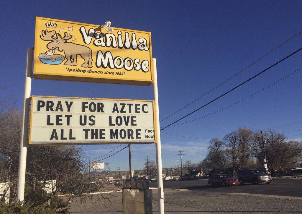 FILE - In this Dec. 8, 2017, file photo, a sign encourages prayer outside an ice cream shop in Aztec, N.M., following a shooting at Aztec High School