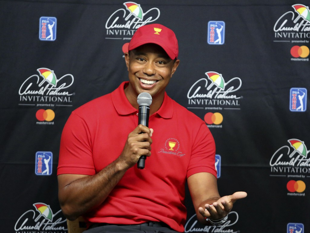 Tiger Woods responds to questions during a news conference at the Arnold Palmer Invitational golf tournament at Bay Hill, Tuesday, March 13, 2018, in