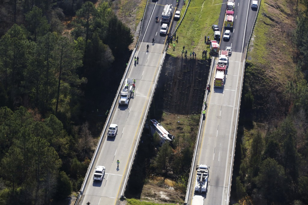 Rescue crews work at the scene of a deadly charter bus crash on Tuesday, March 13, 2018, in Loxley, Ala. The bus carrying Texas high school band membe