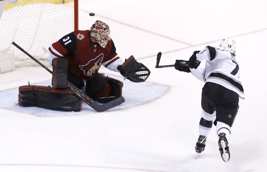 Los Angeles Kings center Tyler Toffoli (73) shoots wide of Arizona Coyotes goaltender Adin Hill (31) during a shootout of an NHL hockey game Tuesday,