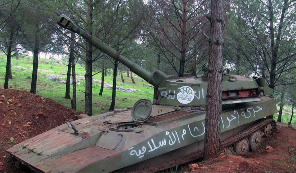 This photo released Feb. 26, 2018, by the al-Qaida-affiliated Ibaa News Agency, shows a tank with markings of the ultraconservative Ahrar al-Sham mili