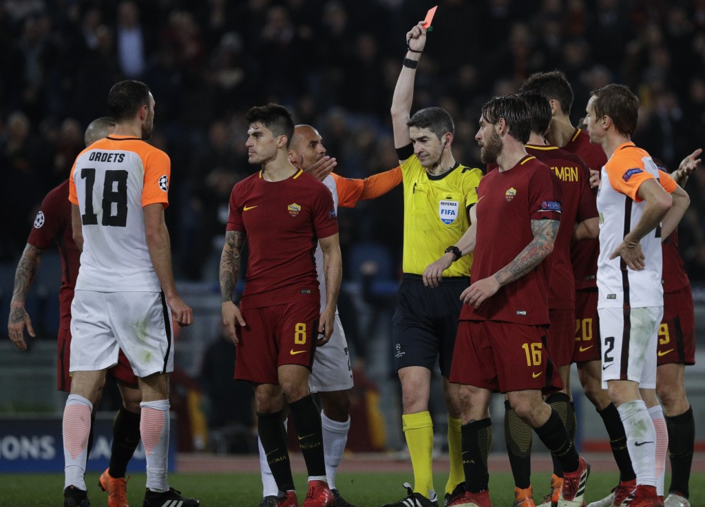 Shakhtar's Ivan Ordets, left, gets a red card during a Champions League round of 16 second-leg soccer match between Roma and Shakhtar Donetsk, at the