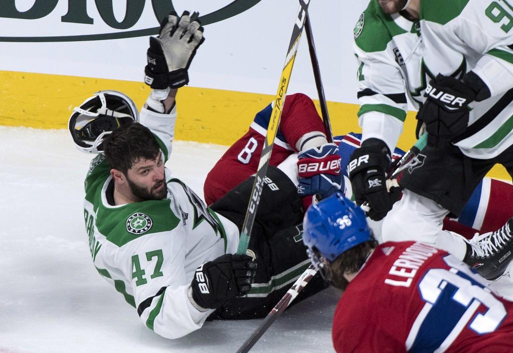 Dallas Stars right wing Alexander Radulov (47) loses his helmet as he is taken down by Montreal Canadiens defenseman Jordie Benn (8) during the first