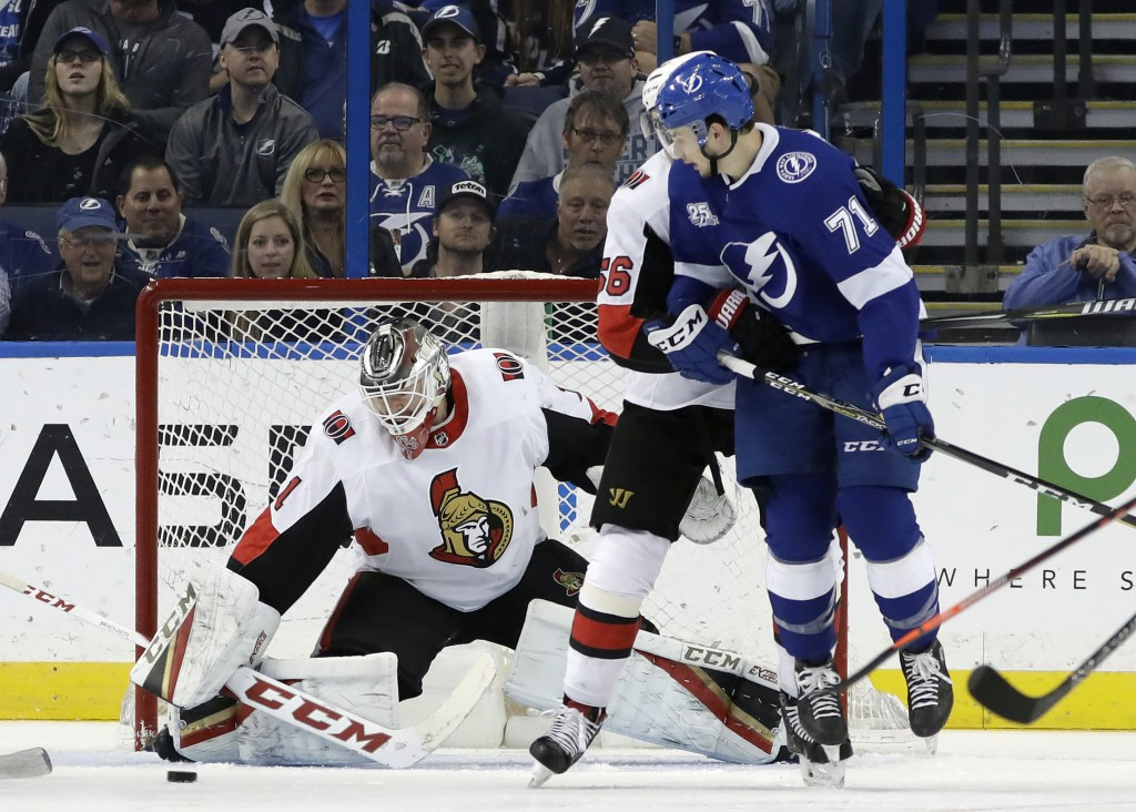 Ottawa Senators goaltender Mike Condon (1) makes a save on a deflection by Tampa Bay Lightning center Anthony Cirelli (71) during the first period of