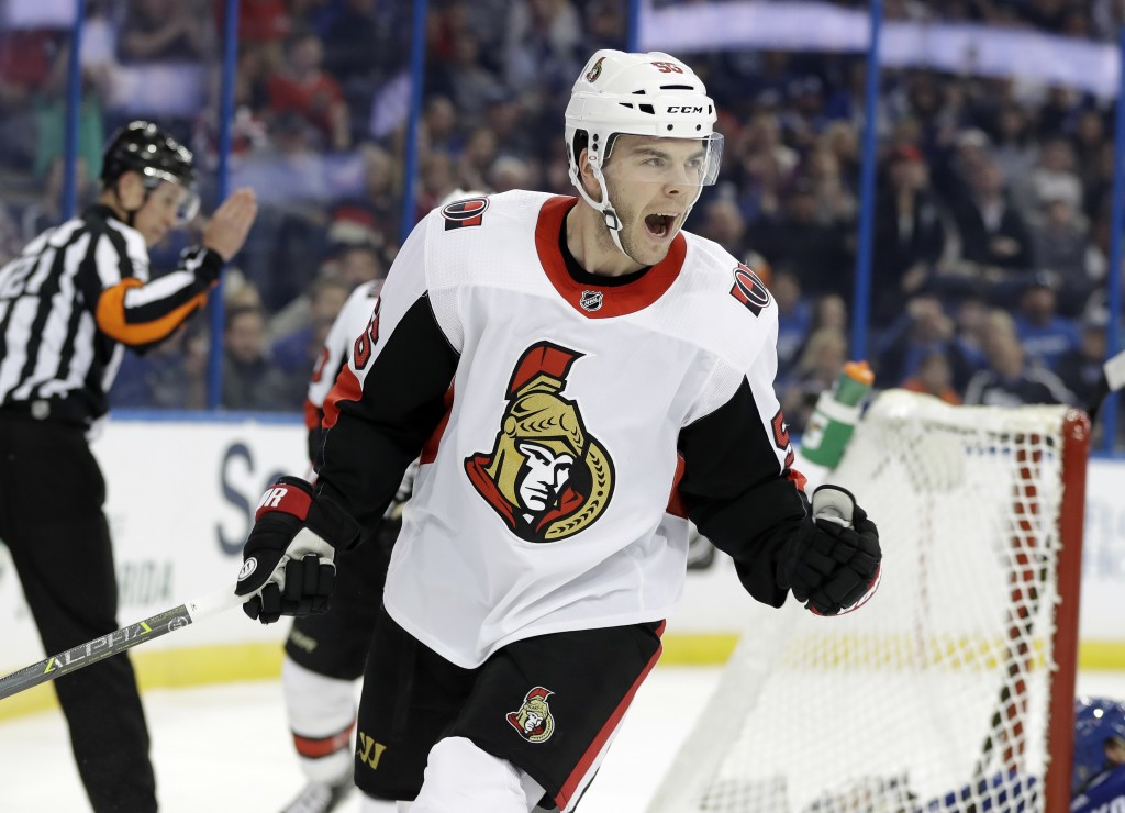 Ottawa Senators left wing Magnus Paajarvi, (56) of Sweden, celebrates after scoring against the Tampa Bay Lightning during the first period of an NHL
