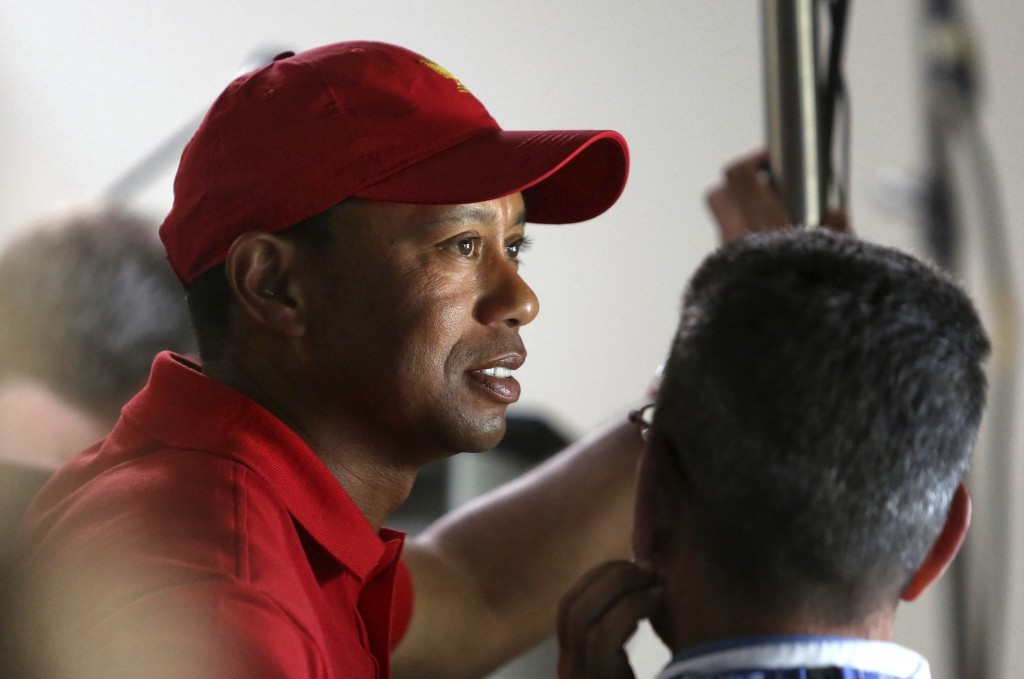 Tiger Woods waits offstage before the start of a news conference at the Arnold Palmer Invitational golf tournament at Bay Hill, Tuesday, March 13, 201