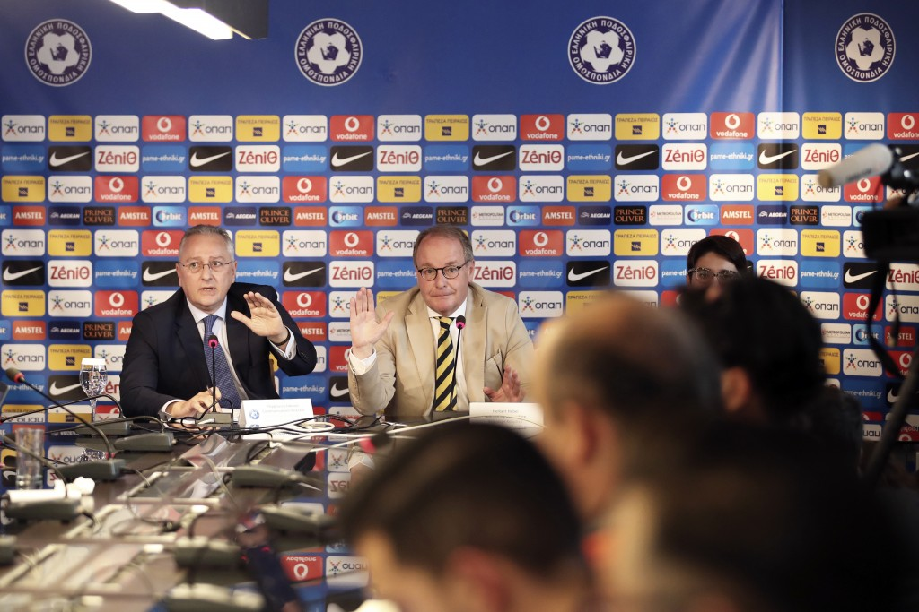 Austrian Herbert Huebel, center, chairman of the FIFA monitoring committee for the Hellenic Football Federation answers a question during a press conf