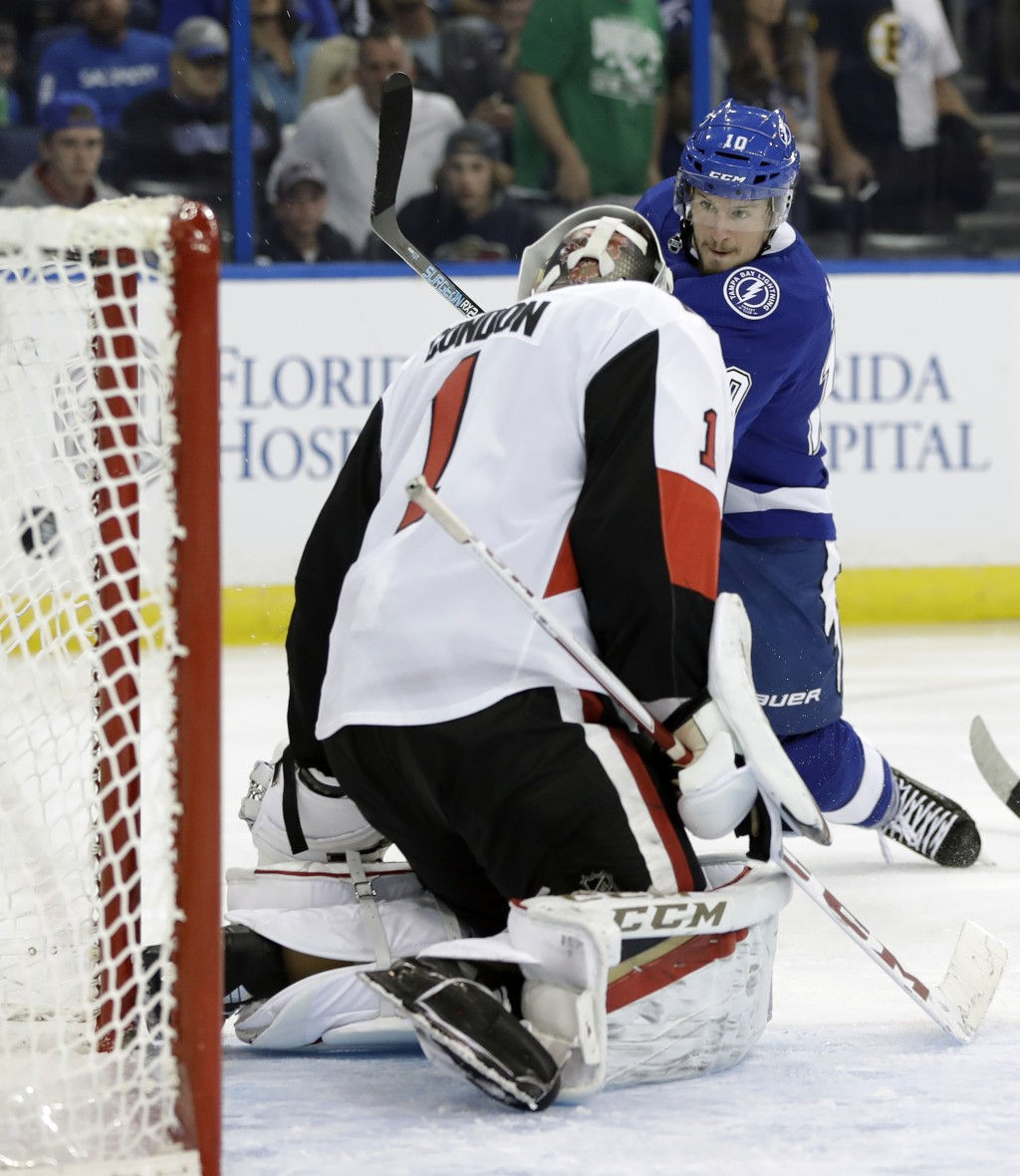 Tampa Bay Lightning center J.T. Miller (10) fires the puck past Ottawa Senators goaltender Mike Condon (1) for a goal during the second period of an N