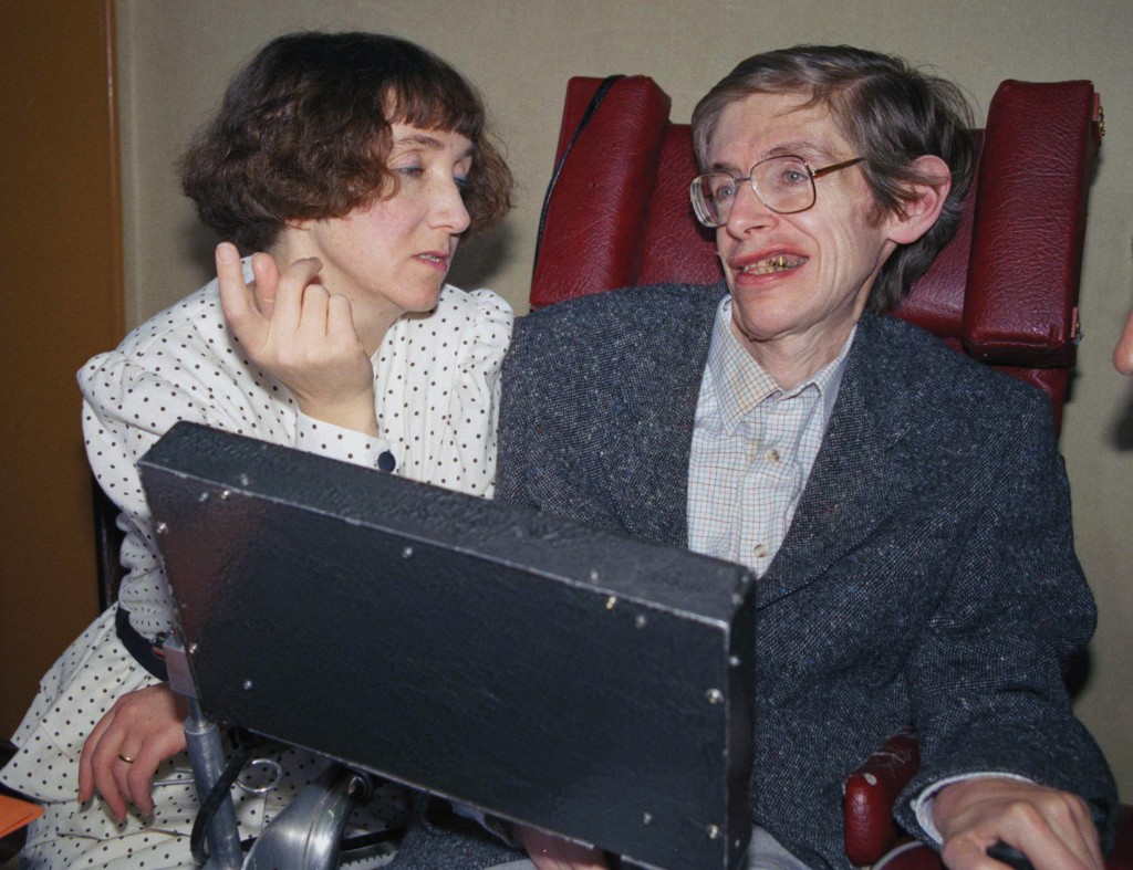 FILE - In this March 3, 1989 file photo British astrophysicist Dr. Stephen Hawking, 47, answers newsmen with the help of his computer and the assistan