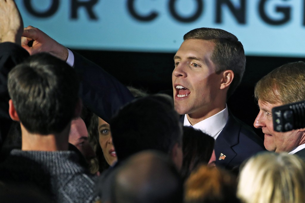 Conor Lamb, the Democratic candidate for the March 13 special election in Pennsylvania's 18th Congressional District, center, celebrates with his supp