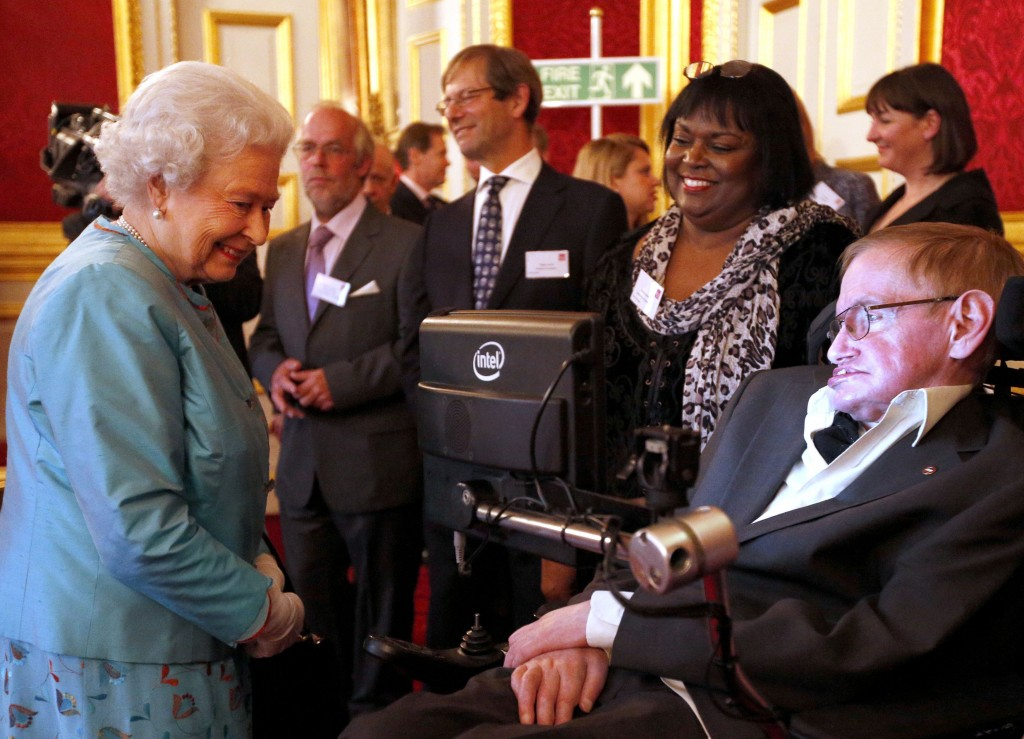 FILE - In this May 29, 2014 file photo, Britain's Queen Elizabeth II meets Professor Stephen Hawking, during a reception for Leonard Cheshire Disabili