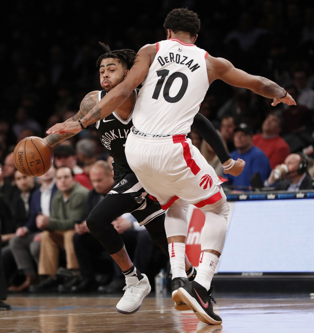 Brooklyn Nets guard D'Angelo Russell (1) collies with Toronto Raptors guard DeMar DeRozan (10) as he drives to the basket during the second half of an