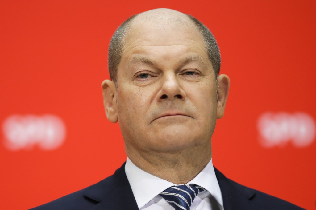 FILE -- In this Sunday, March 4, 2018 photo new German Finance Minister Olaf Scholz attends a press conference in Berlin, Germany. (AP Photo/Markus Sc