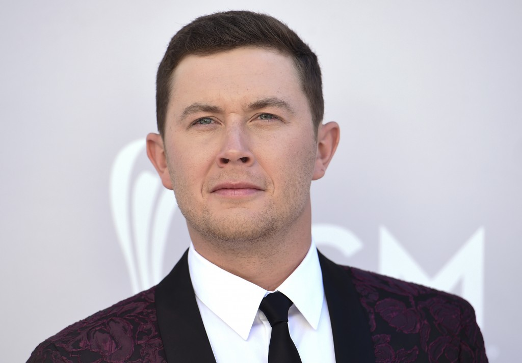 FILE - In this April 2, 2017 file photo Scotty McCreery arrives at the 52nd annual Academy of Country Music Awards at the T-Mobile Arena in Las Vegas.
