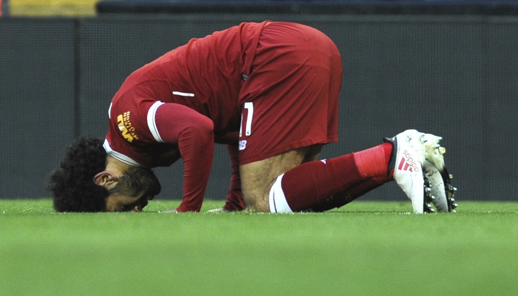 FILE - In this Feb. 24, 2018 file photo, Liverpool's Egyptian star striker Mohammed Salah offers a prayer after scoring a goal during the English Prem