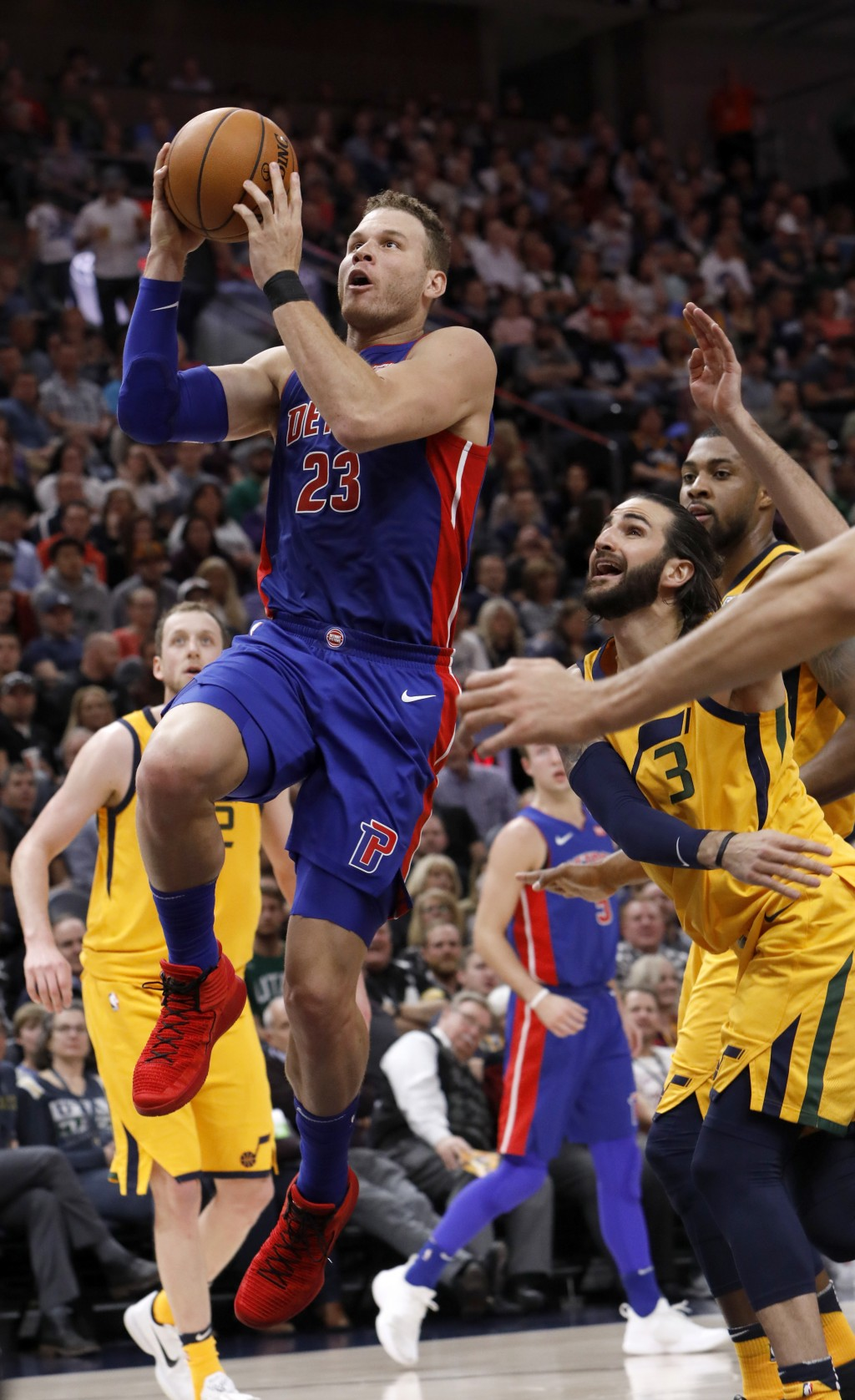 Detroit Pistons' Blake Griffin (23) attempts a layup as Utah Jazz's Ricky Rubio (3) defends in the first half of an NBA basketball game on Tuesday, Ma