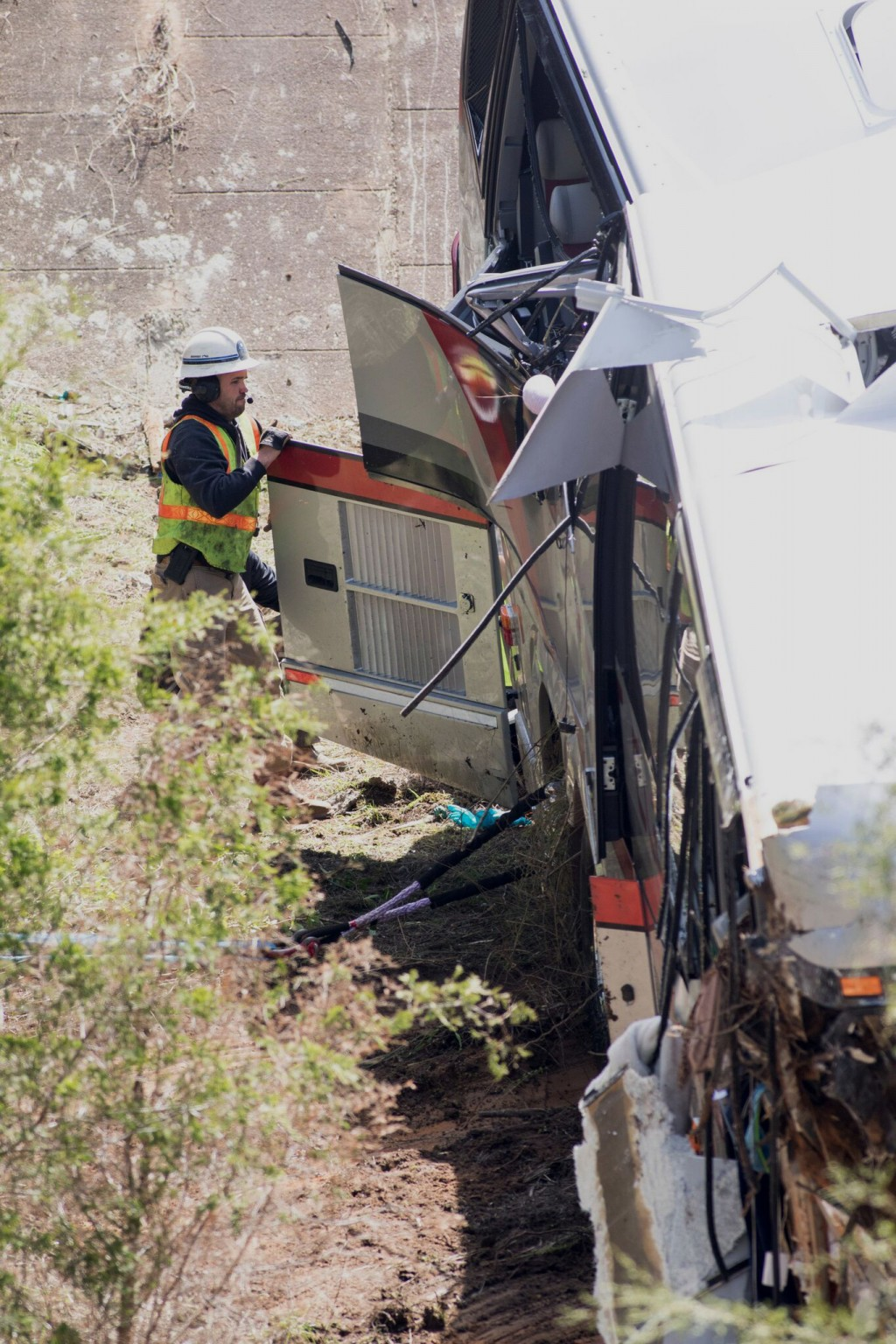 Emergency personnel looks into a bus that crashed into a ravine in Loxley, Ala., Tuesday, March 13, 2018. The bus carrying dozens of students and six