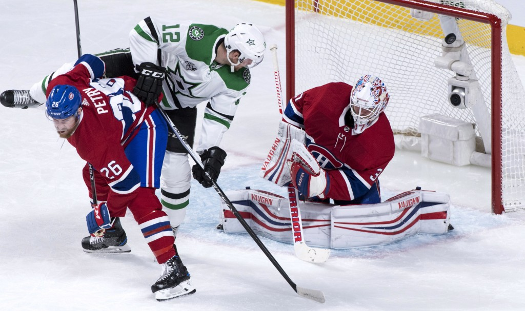 Dallas Stars center Radek Faksa (12) gets tangled up with Montreal Canadiens defenseman Jeff Petry (26) as he scores past goaltender Antti Niemi (37)