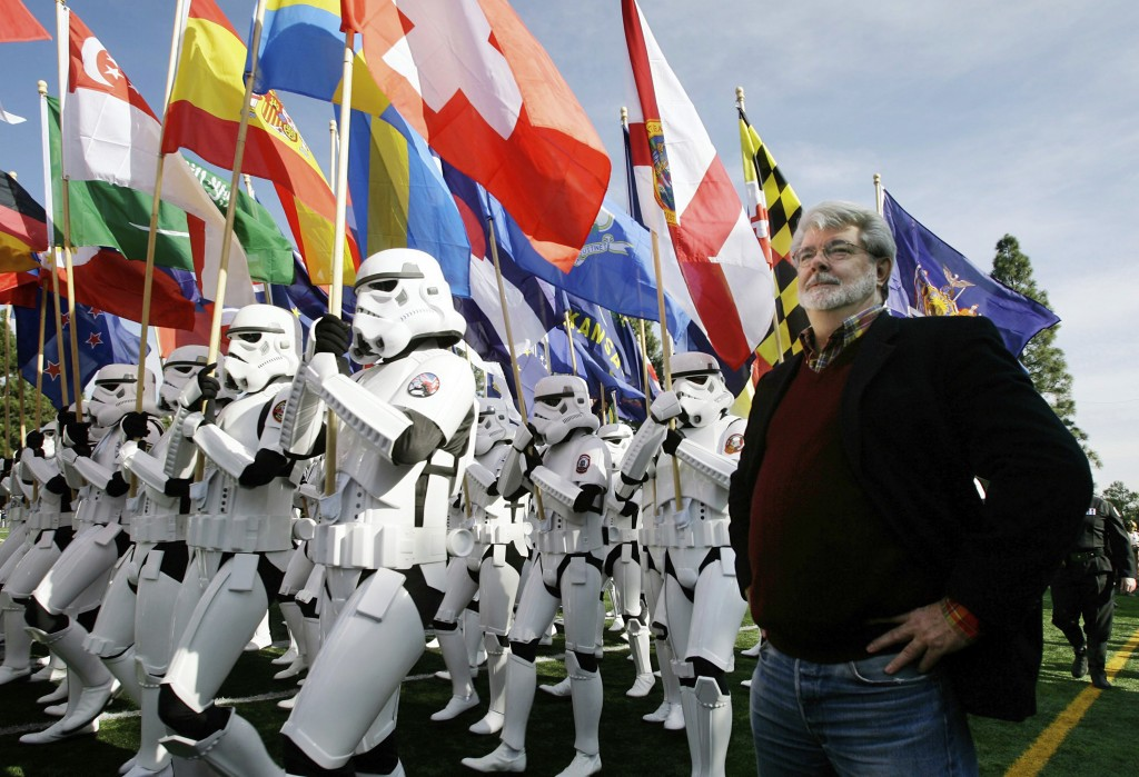 FILE - In this Dec. 31, 2006, file photo, Star Wars director George Lucas, reviews members of the 501st Legion, a group of Star Wars fans dressed as s