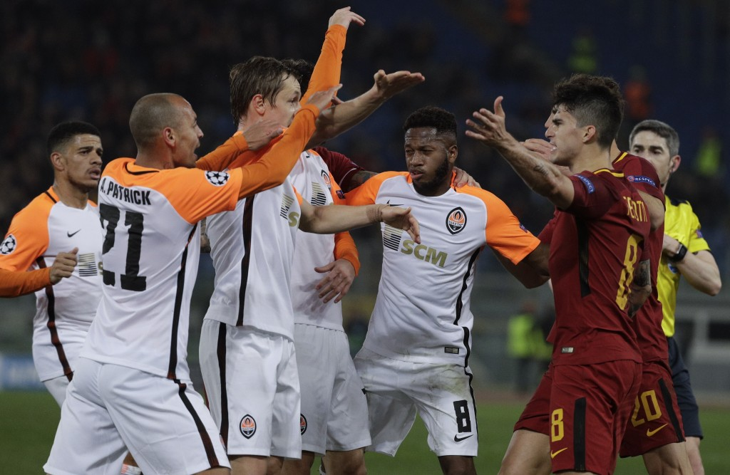 Roma and Shakhtar players face each others during a Champions League round of 16 second-leg soccer match between Roma and Shakhtar Donetsk, at the Rom