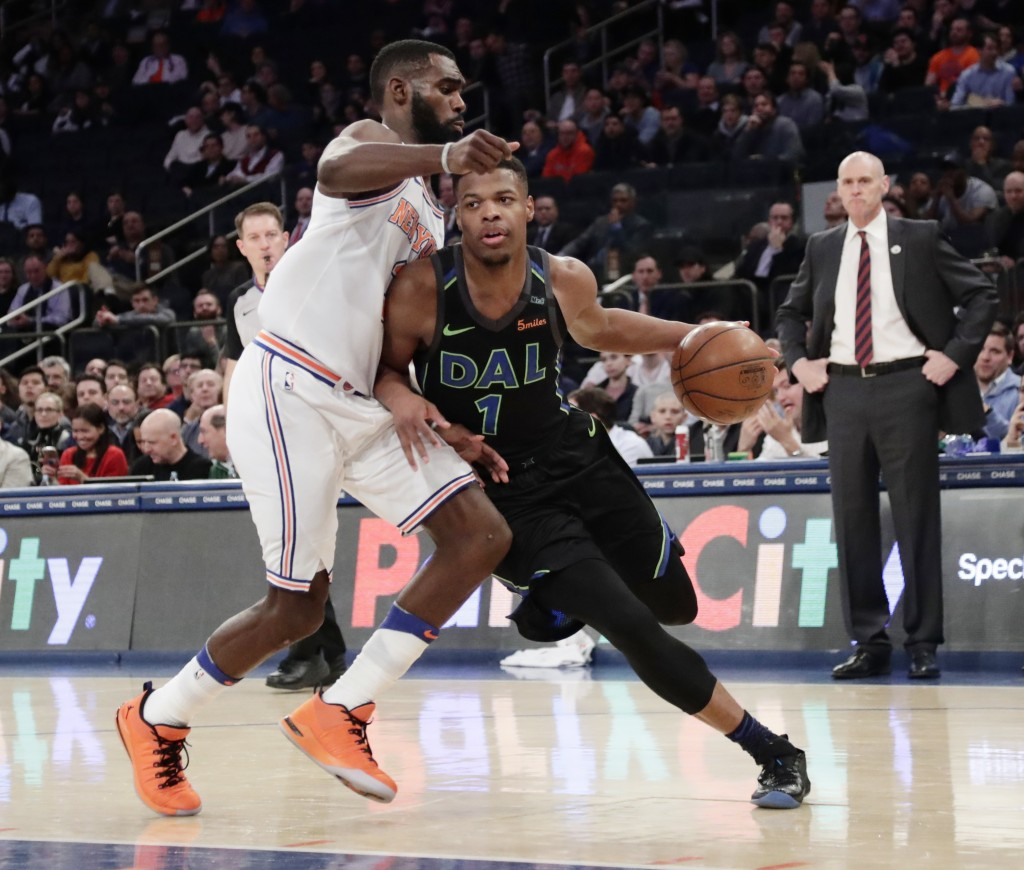 Dallas Mavericks' Dennis Smith Jr. (1) drives past New York Knicks' Tim Hardaway Jr. (3) during the first half of an NBA basketball game Tuesday, Marc