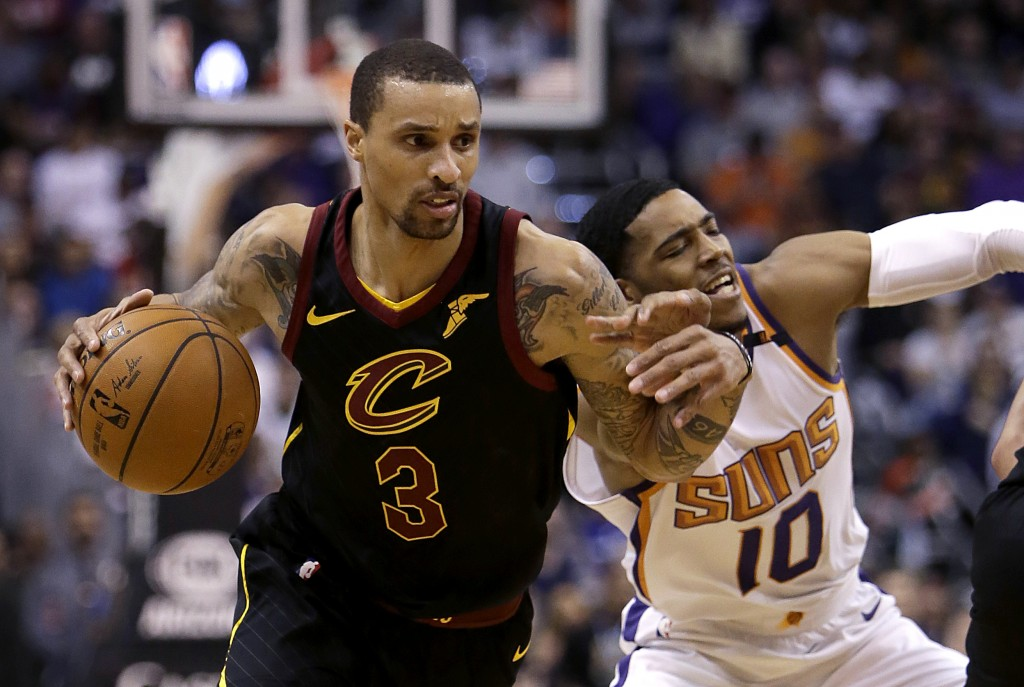 Cleveland Cavaliers guard George Hill (3) drives on Phoenix Suns guard Shaquille Harrison in the first half during an NBA basketball game, Tuesday, Ma