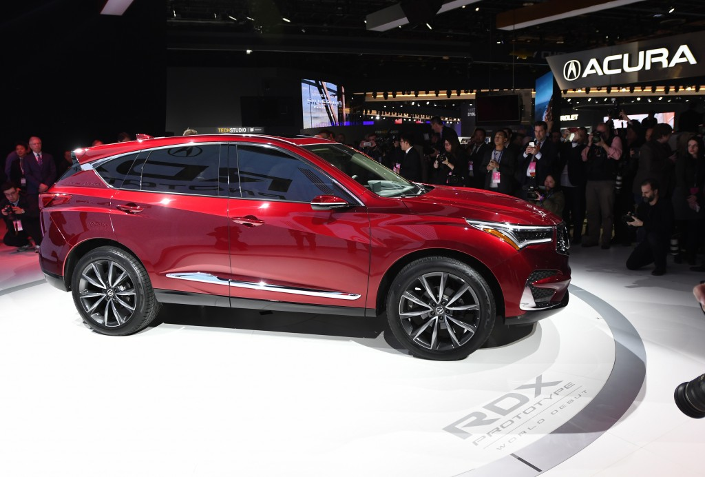 FILE- In this Jan. 15, 2018, file photo, members of the media photograph the Acura RDX at the North American International Auto Show in Detroit. The 2
