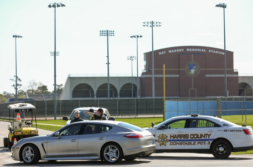 Harris County Precinct 3 Constable's Office deputies guide traffic into Channelview High School on the intersection of Crockett and Sheldon roads Tues