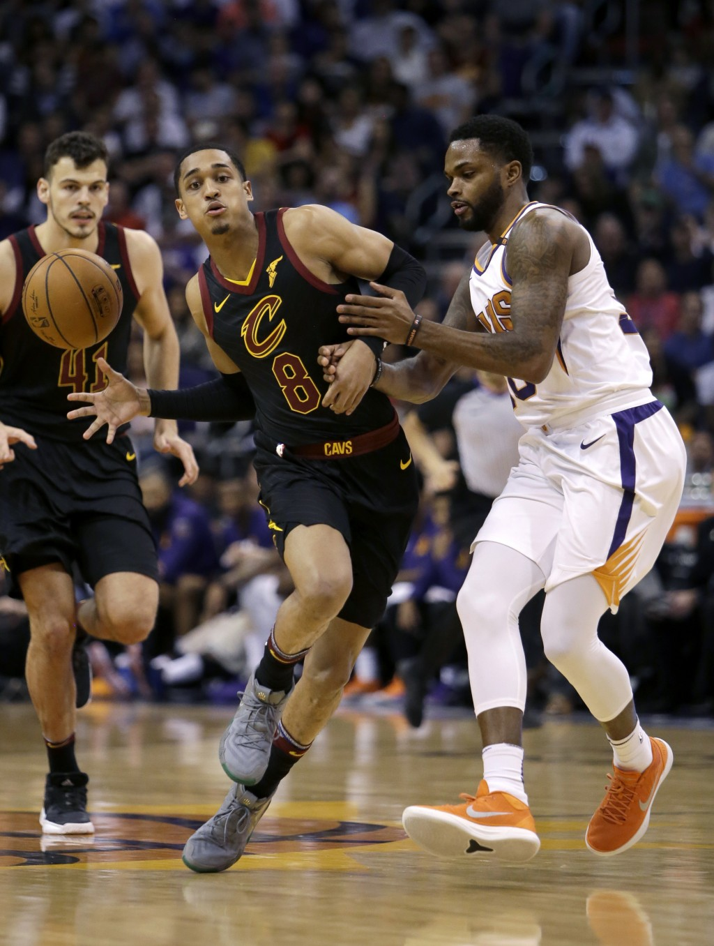 Cleveland Cavaliers guard Jordan Clarkson (8) drives on Phoenix Suns guard Troy Daniels in the first half during an NBA basketball game, Tuesday, Marc