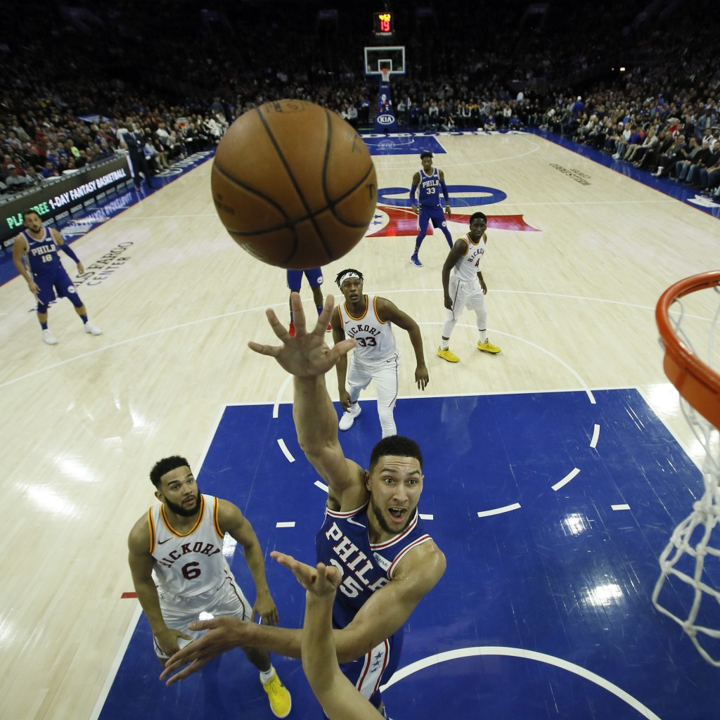 Philadelphia 76ers' Ben Simmons (25) goes up for a shot past Indiana Pacers' Cory Joseph (6) during the first half of an NBA basketball game, Tuesday,
