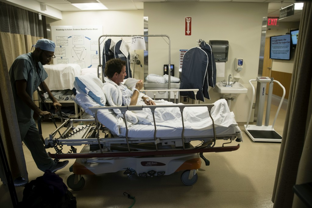 Ryan Ciccozzi is taken to surgery at the Hospital of the University of Pennsylvania in Philadelphia, Tuesday, Jan. 23, 2018. During Ciccozzi's surgery